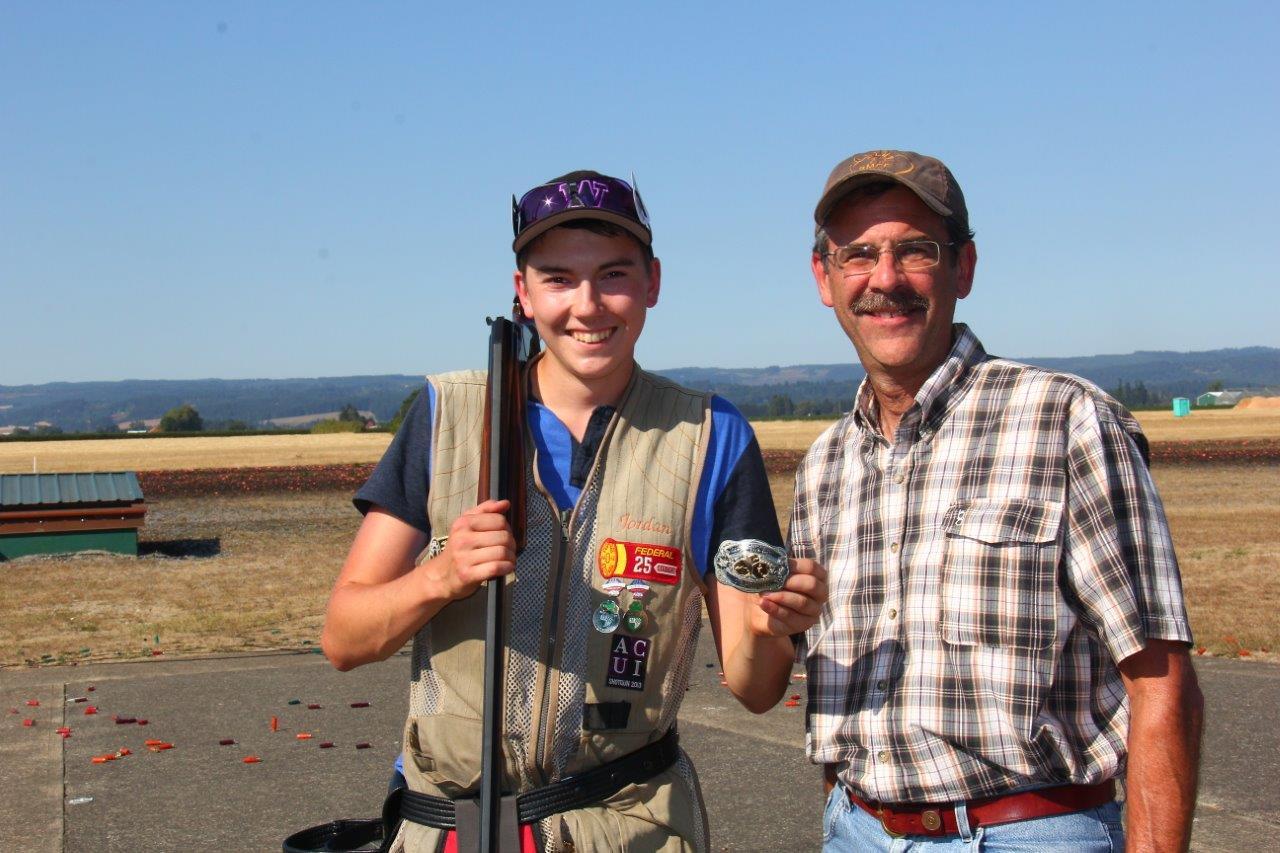 Jordan Musgrove receiving Handicap Champion buckle at the Nut Shoot from Randy Lederbrand
