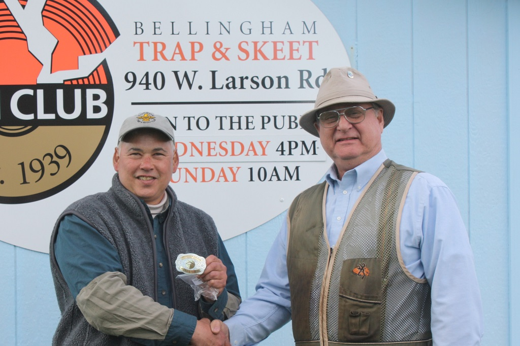 Tom Rock receives buckle from Larry Stewart at Bellingham