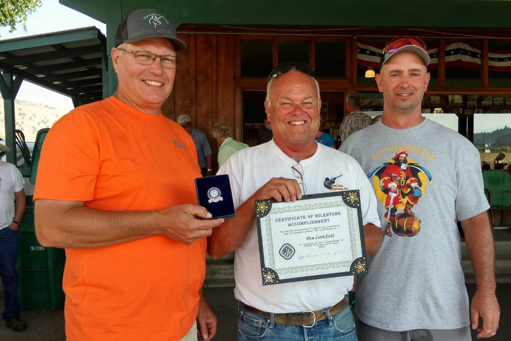 Don Littlefield receives his 100000 milestone from John and Mike