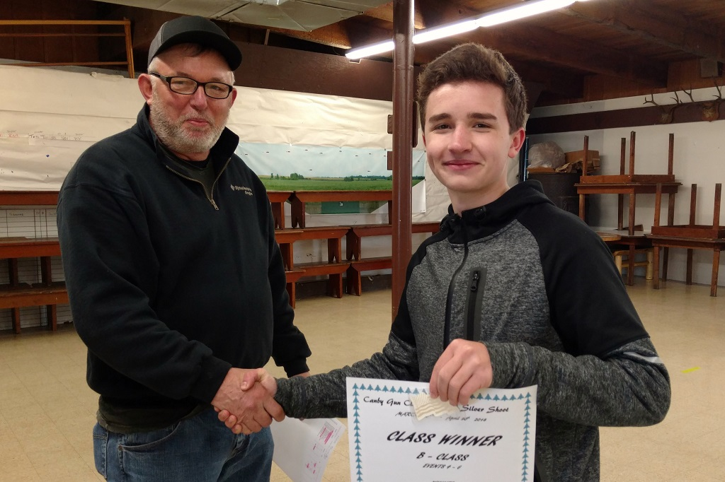 Cameron Phillips receives HOA B class from Wayne at Canby shoot