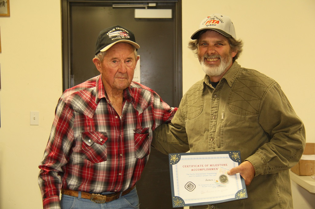 Chuck Curtis presents James Adair his 50,000 milestone award at Bend Trap Club