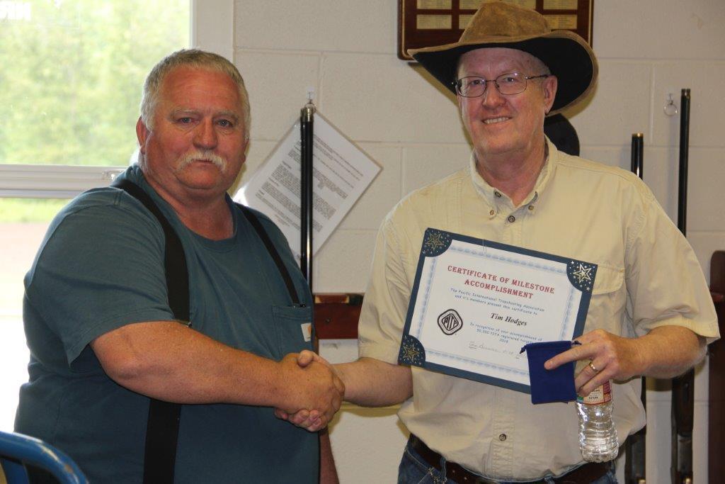 Jim Bradbury presents Tim Hodges his 50000 milestone award at Black Diamond
