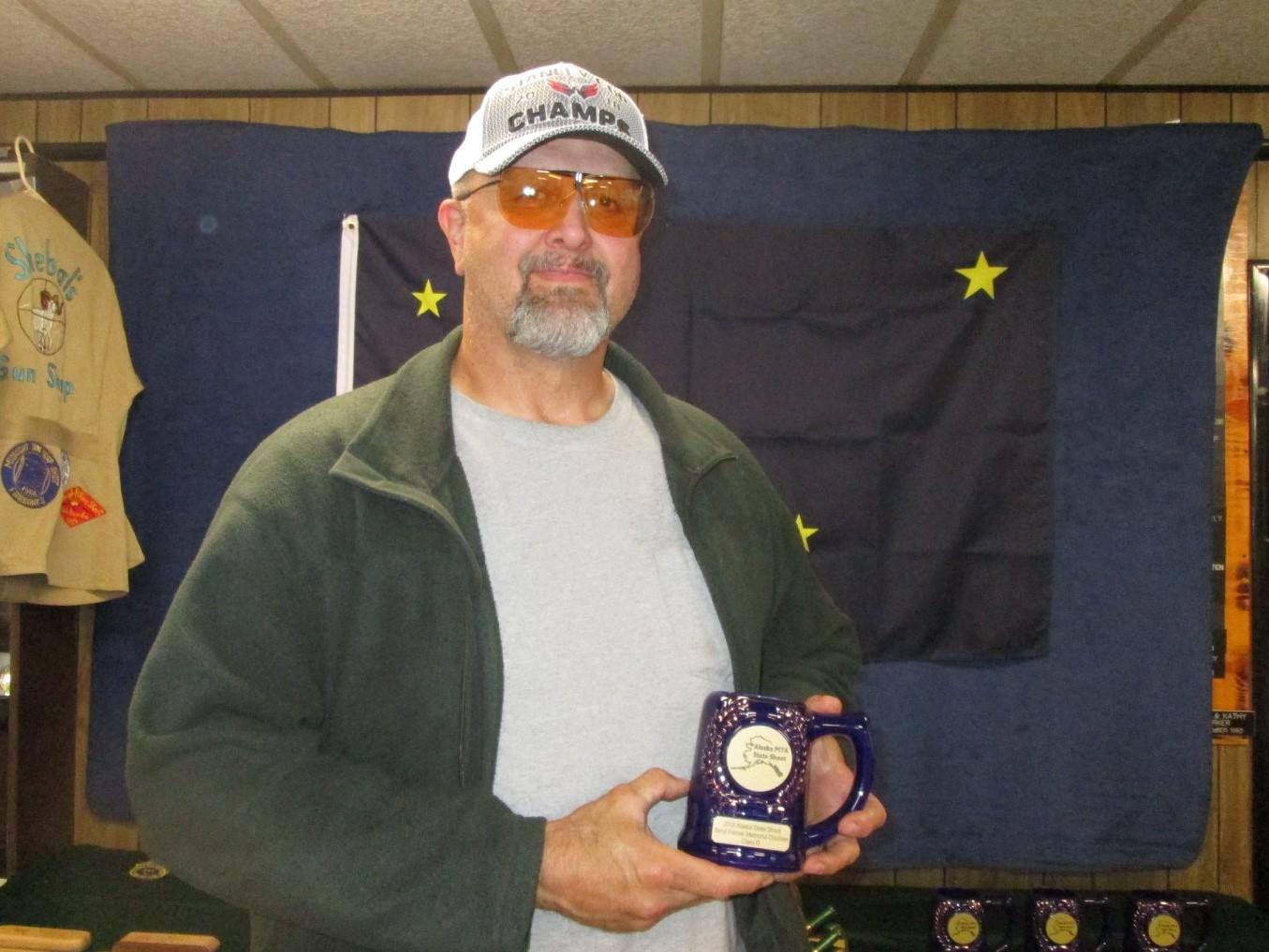 Jim Kurkowski wins D class doubles at AK State Shoot