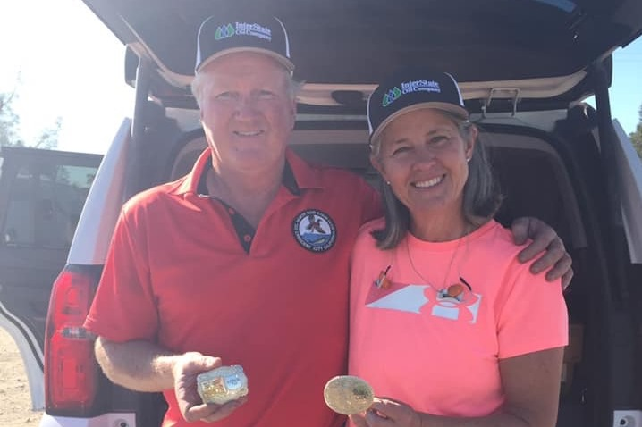 Mac and Karen Robertson win Redding Toys for Tots buckles