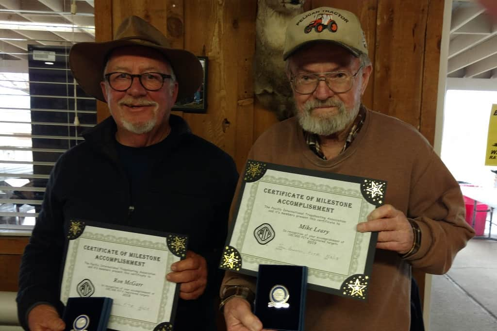 Ron McGarr and Mike Leary receive 100,000 target milestone award