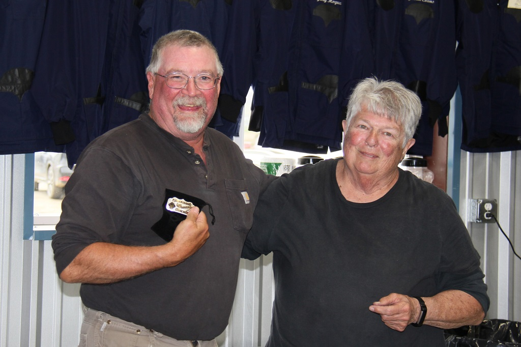 Gary Hogue recieves his Most Targets & 50,000 pin from Betty Phipps