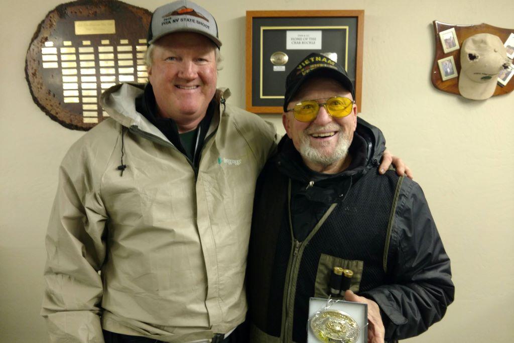 Mac presents Billy Denham with his Crab Buckle