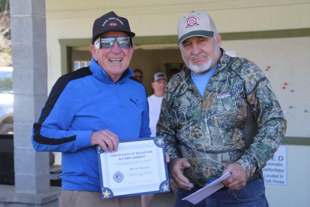 Merritt Winchell recieved his 50,000 target milestone award from Lance Howard