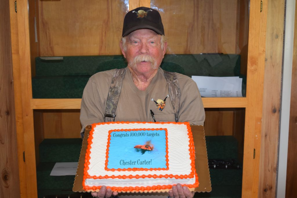 Chester Carter  with his 100,000 target milestone cake