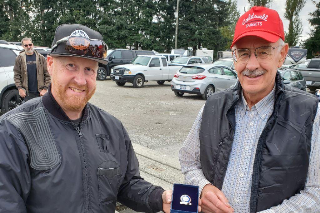 Darryl Webber (right) hits his 100,000 target milestone