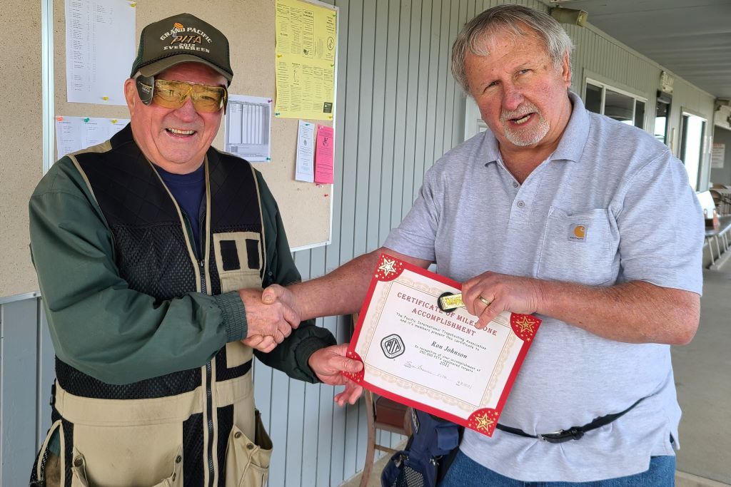 Ron Johnson receives his 250,000 Milestone money clip from Ron H